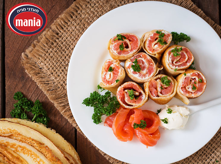 "Appetizing pancakes with salmon and cream cheese ""Philadelphia""."